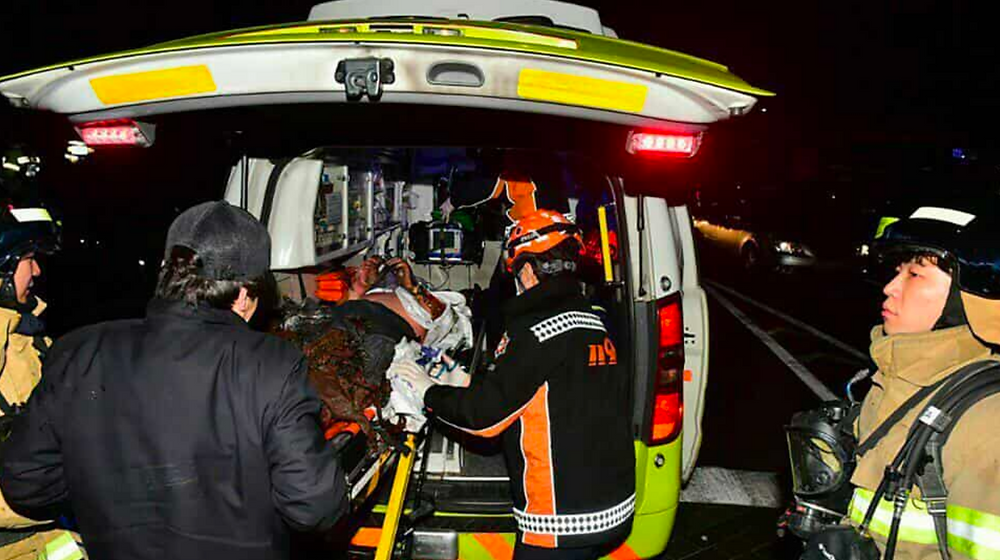 Monk in ambulance.