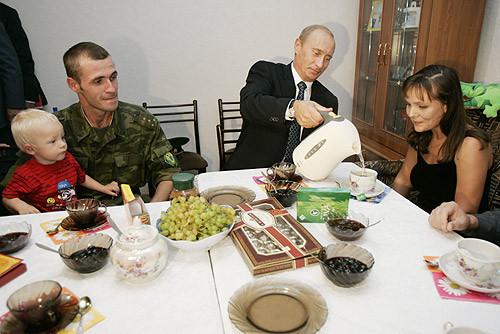 Putin pouring tea.