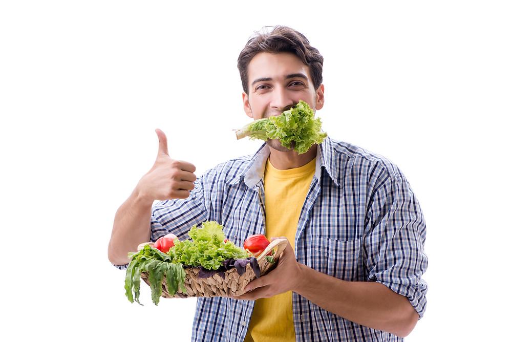 Vegan eating lettuce.