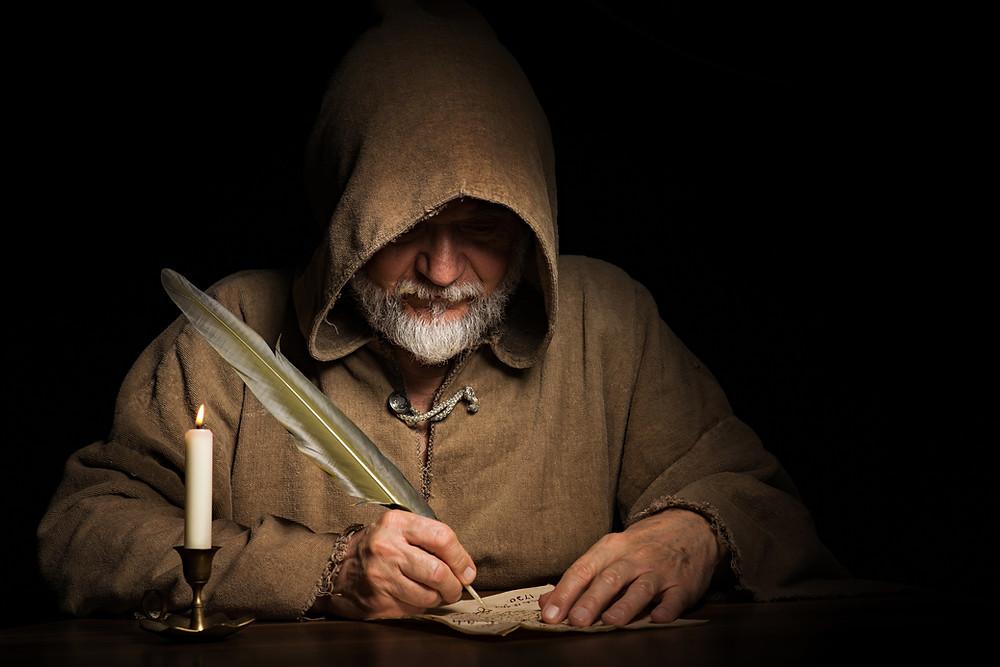 Monk writing.