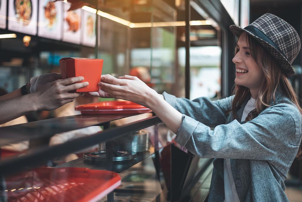 Woman buying chinese takeaway