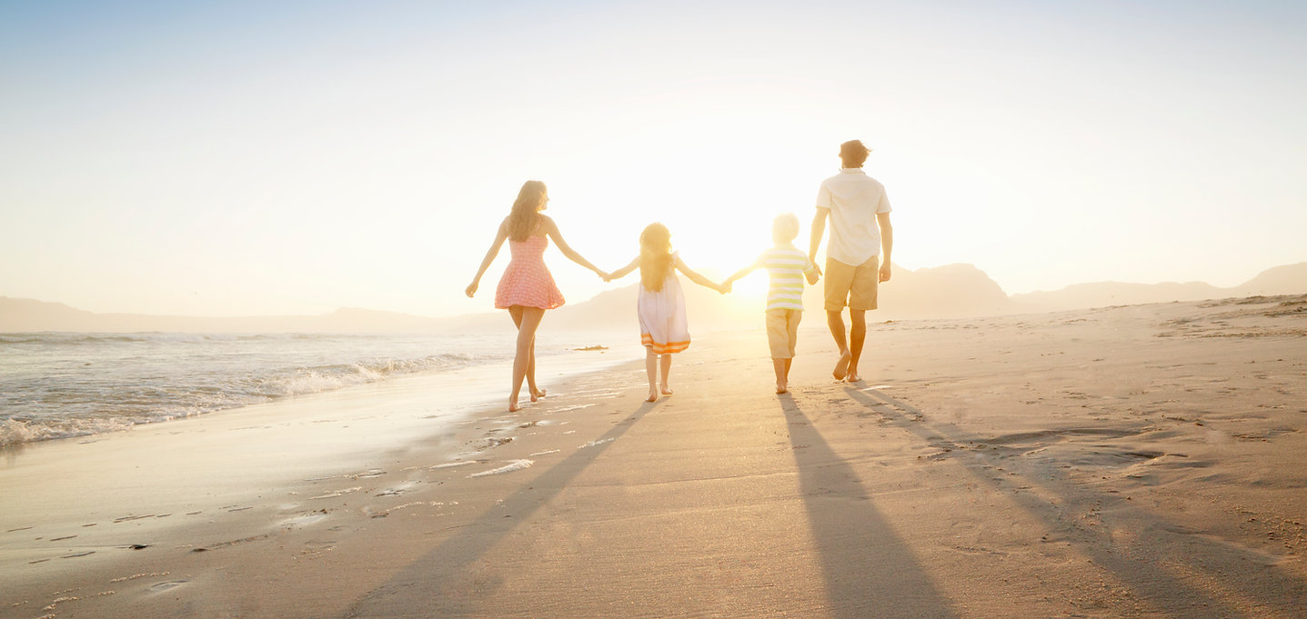 Healthy Family Walking On the Beach