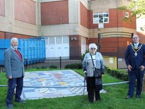 Alice in Wonderland mosaic gets new home