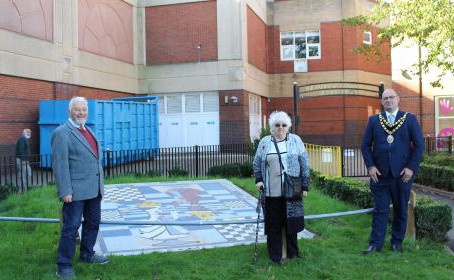 Alice in Wonderland mosaic gets new home