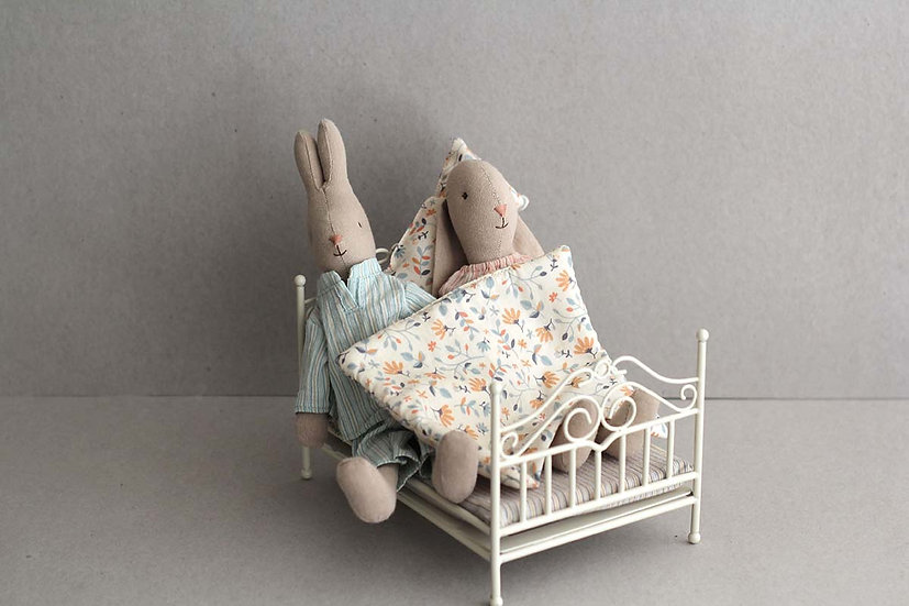 Mummy and Daddy rabbit in Bed.