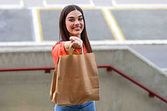 Woman-holding-brown-paper-bag-donation-s