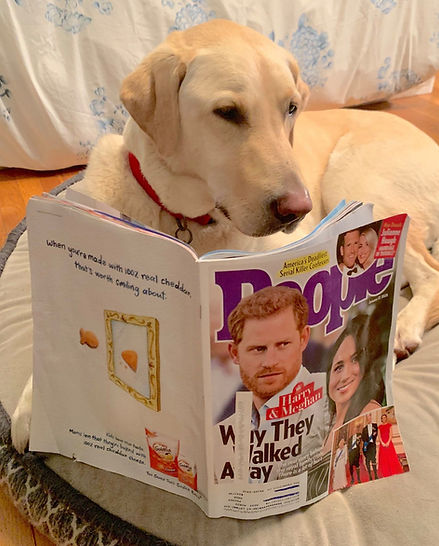 Gus reads People.jpg