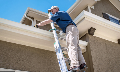 Person wearing home inspector body cameras while climbing a ladder