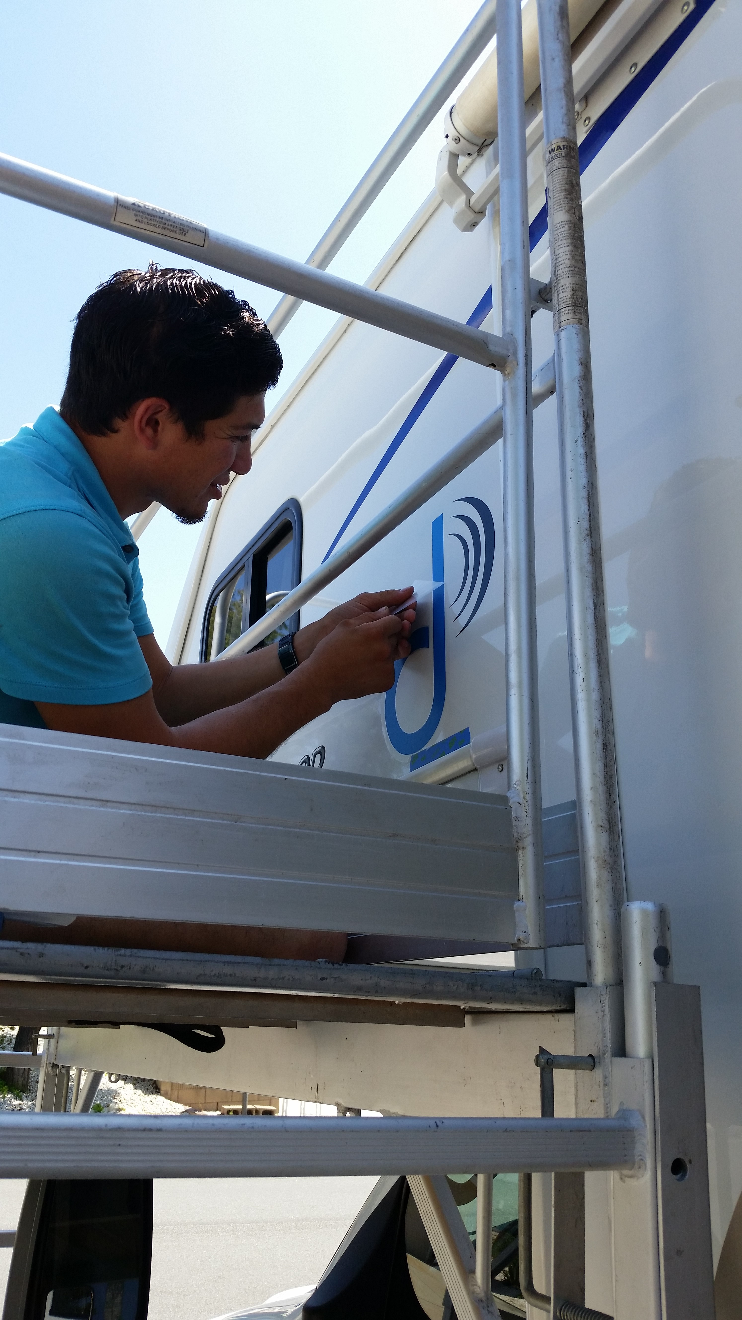 Installation of decals on RV