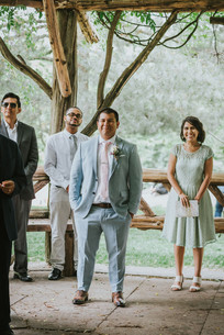 Photo of groom, groomsmen, and Spanish-speaking officiant from Once Upon A Vow as they see the bride walking towards them