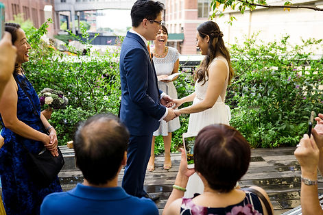 Intimate elopement ceremony at the Highline in Manhattan with smiling couple and laughing wedding officiant from Once Upon A Vow