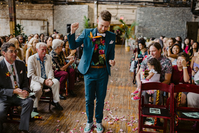 Groom dances down the aisle right before the fun ceremony officiated by Once Upon A Vow in Greenpoint Brooklyn
