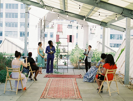 Intimate Elopement Ceremony with Once Upon A Vow at Brooklyn Grange for interracial LGBTQ couple and four guests