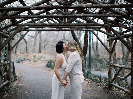 Central Park elopement ceremony with LGBTQIATS interracial couple with queer officiant, Karla, and queer photographer, Judson Rappaport, as part of the Once Upon A Vow NYC Elopement Team