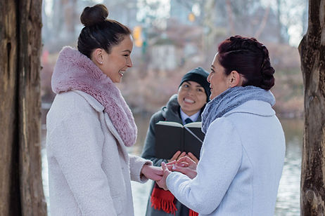 Winter wedding elopement at Wagners Cove with two smiling brides exchanging wedding rings being married by queer officiant at Once Upon A Vow