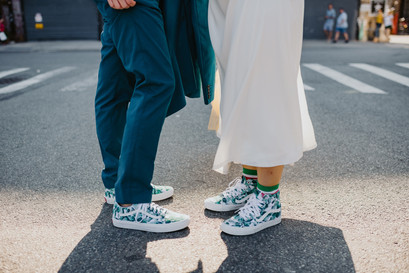 Portrait of bride and groom's tropical footwear set in the middle of the street in Greenpoint, Brooklyn