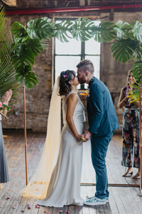 First married kiss between the couple as the Brooklyn officiant from Once Upon A Vow pronounces them married in Brooklyn's Greenpoint Loft
