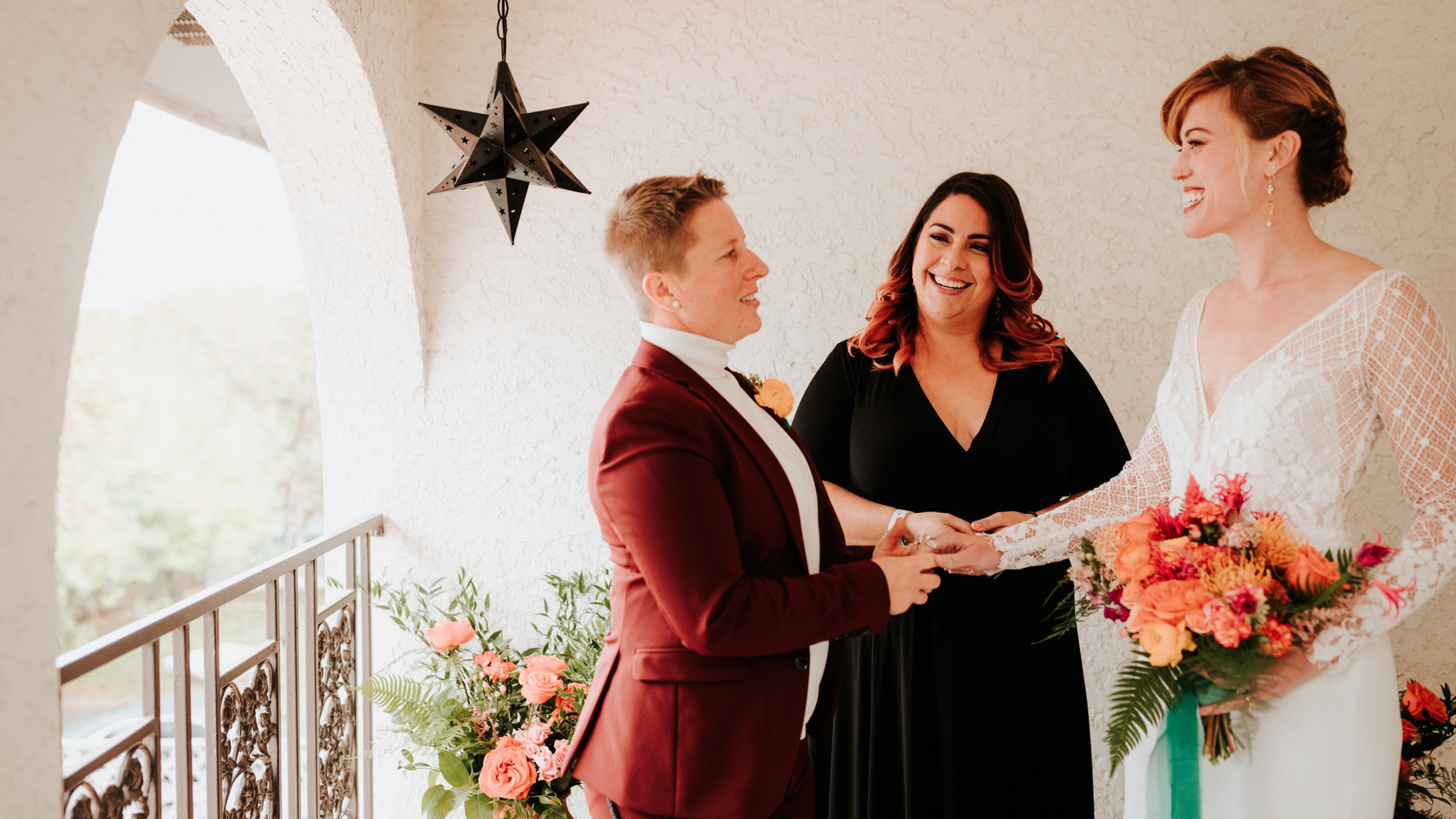 Intimate wedding ceremony with LGBTQ couple centering Marie from Lets Get Married by Marie as the officiant