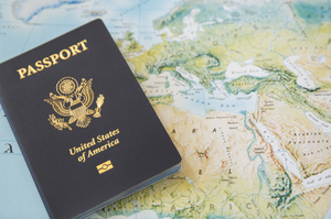 A passport is an example of proper photo ID to obtain a marriage license in the city of New York