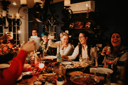 Radical Wed Retreat dinner of wedding vendors having fun and raising their glasses to each other during a delicious dinner
