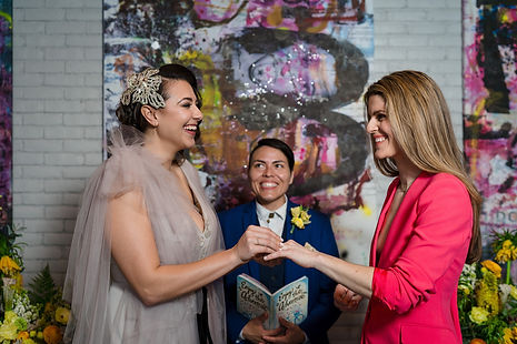 Colorful LGBTQ Intimate Ceremony at 50 Bowery with smiling wedding officiant from Once Upon A Vow