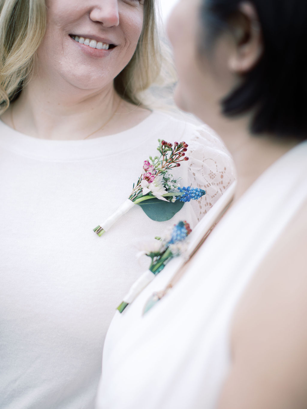 Close-up shot of corsages; taken post elopement ceremony officiated by queer officiant at Once Upon A Vow.