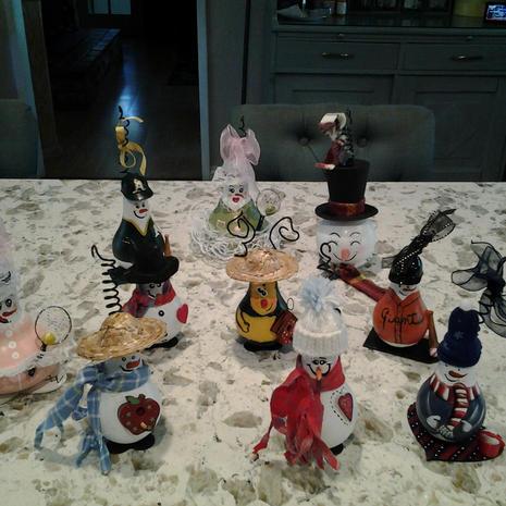 Lightbulb ornaments: Tennis lady w/racket and ball; A's baseball w/bat and ball; snowman head; snowman ornaments: bumblebee; Giants baseball w/bat and ball.