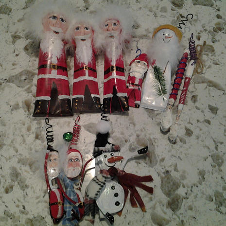 Toothpaste tube Santas (3 large, 1 small); toothpaste tube snowman; 2 toothbrush Santas; 2 eyeglass Santas; 1 eyeglass snowman ornaments