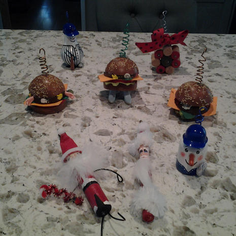 NY Yankees lightbulb; Cork snowflake; 3 hamburgers; shotgun shell Santa; spindle Santa; bottle LA Dodgers with Dodger pin ornaments