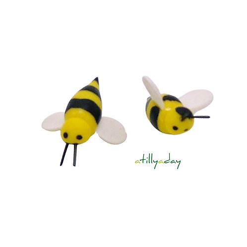 Yellow bee with black stripes bee figurines