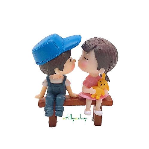 Couple Figurine on Bench