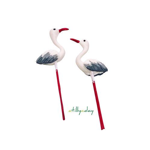 White flamingo with red beak figurine