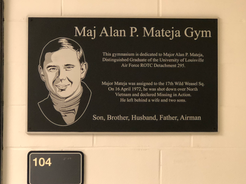 Plaque on entrance to gym