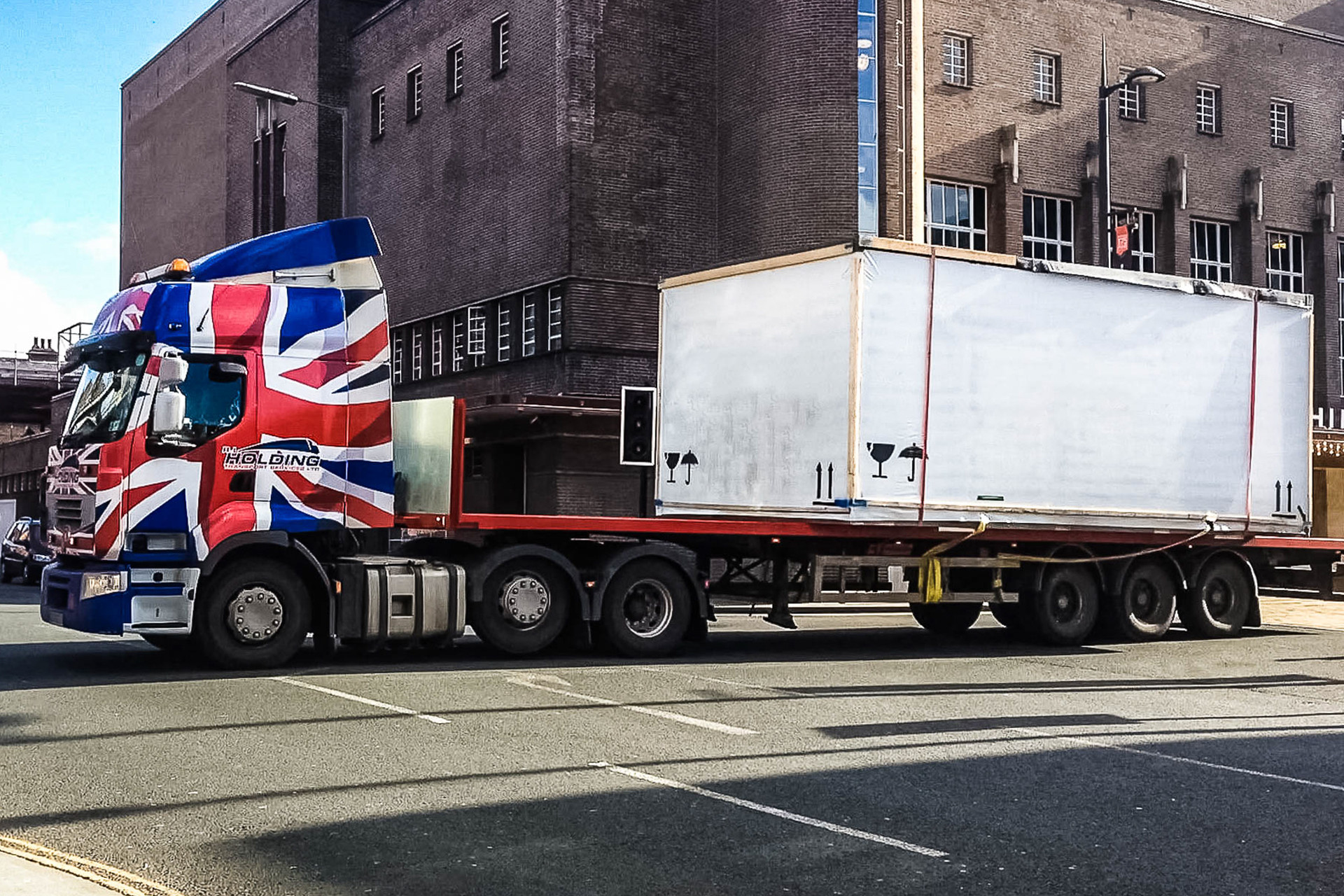"""<img src=""""module.jpg"""" alt=""""delivery of a modular unit on a lorry""""/>"""