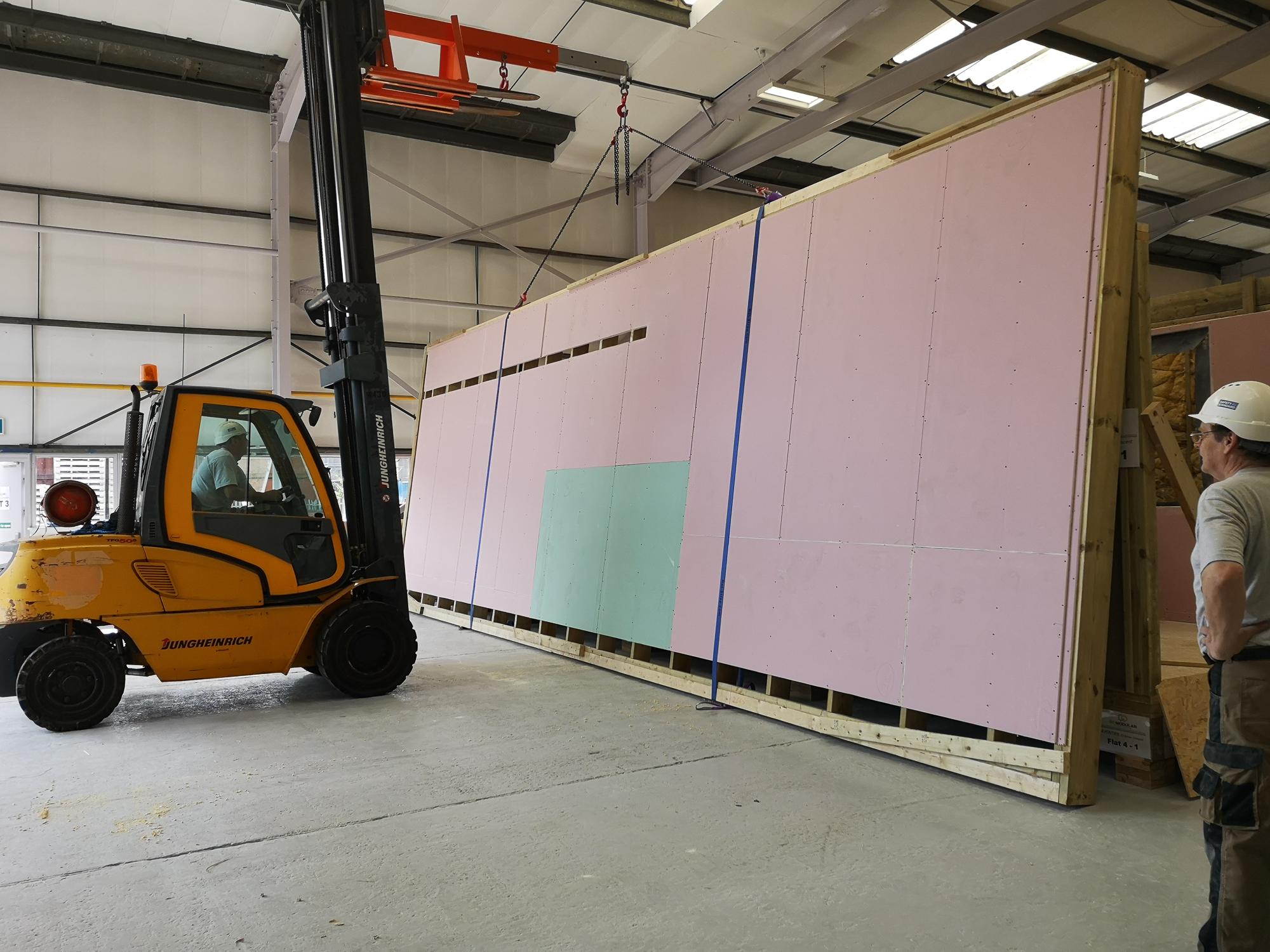 """<img src=""""modular construction.jpg"""" alt=""""modular factory, forklift lifting modules""""/>"""