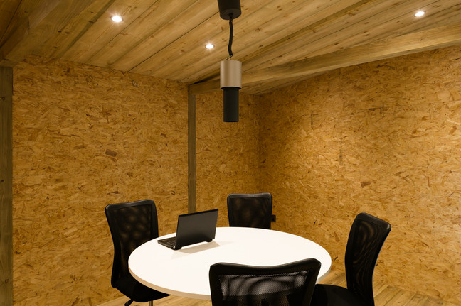 """<img src=""""office interior.jpg"""" alt=""""four chairs around the table in modular office""""/>"""