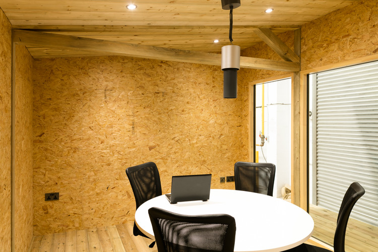 "<img src=""office interior.jpg"" alt=""four chairs around the table in modular office""/>"