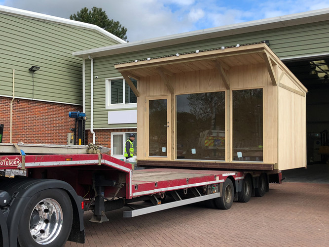 "<img src=""modular garden unit.jpg"" alt=""delivery of a garden unit on a lorry""/>"