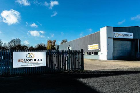 "<img src=""Go Modular Factory.jpg"" alt=""modular factory entrance""/>"