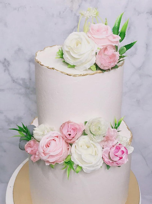 Pastel Pink And White Two Tier Wedding Cake