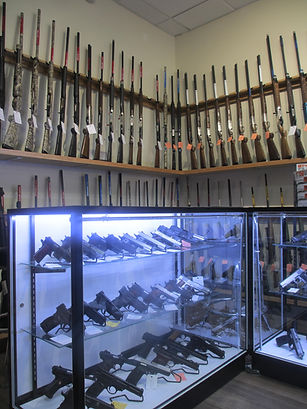 Lage selection of guns and gun accessories