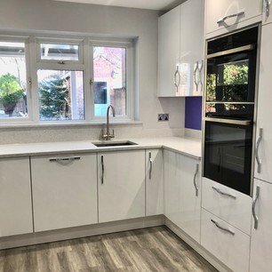 Modern white kitchen and ash wood floor