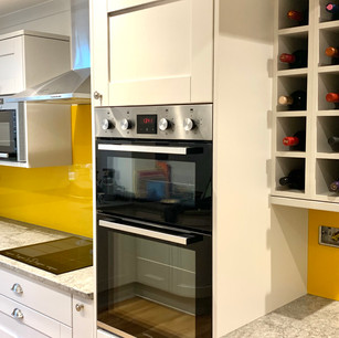 Modern kitchen with yellow backsplash