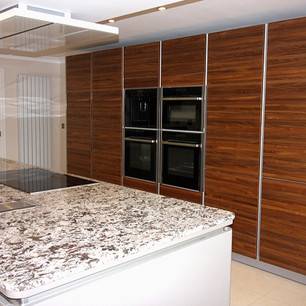 Minimalist kitchen with marble island