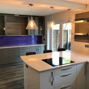 Modern white kitchen with small island