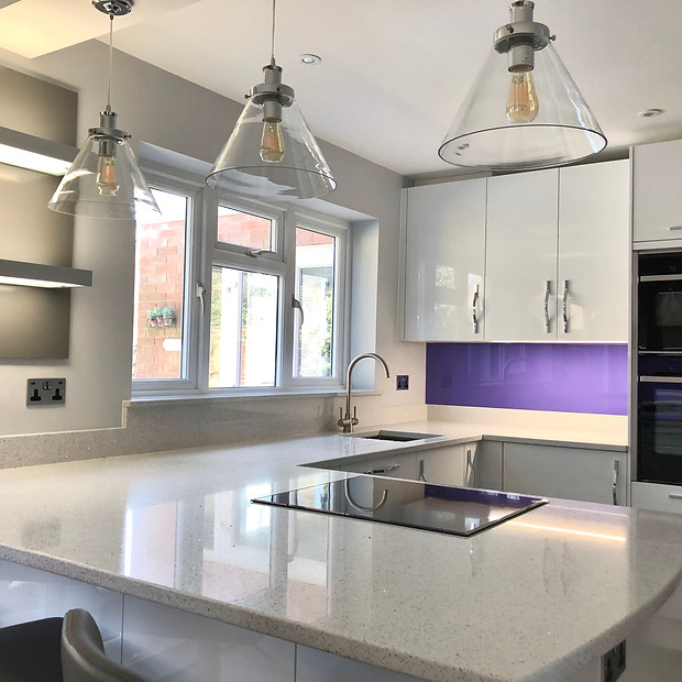 Modern white kitchen with pendant lights