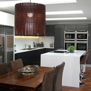 Modern highgloss kitchen and dark wood