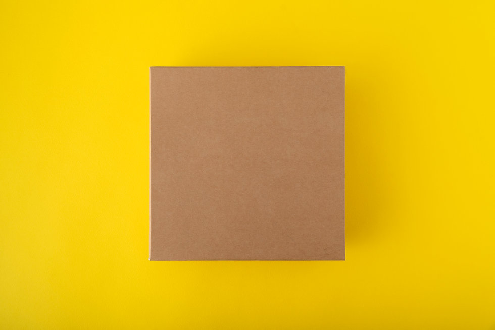square-cardboard-box-on-yellow-backgroun