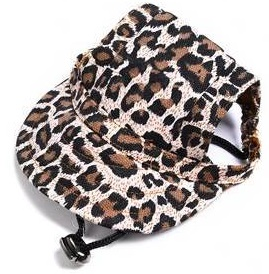 View of side of animal print cap on dog