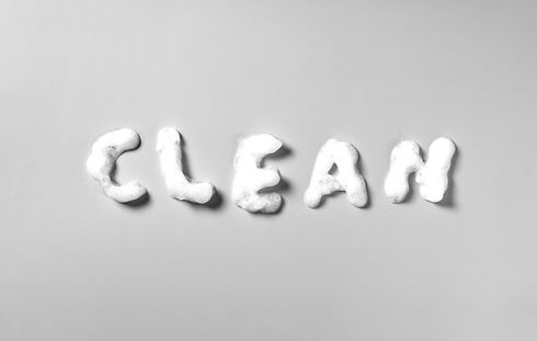 The concept of CLEAN. beauty, hygiene and skin care written in bubble letters on a green b